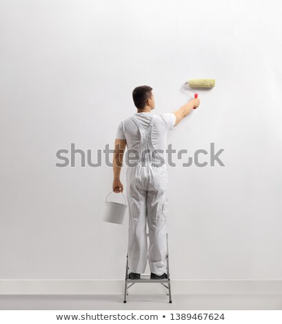 man standing on a ladder and painting a wall stock photo © photography33