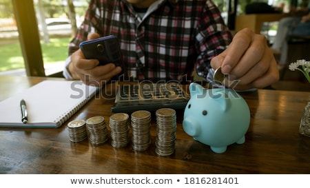 Woman holding piggy bank Stock photo © Ronen