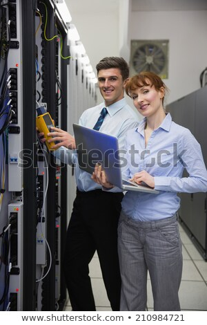 Three technicians looking at laptop in data center Stock photo © wavebreak_media