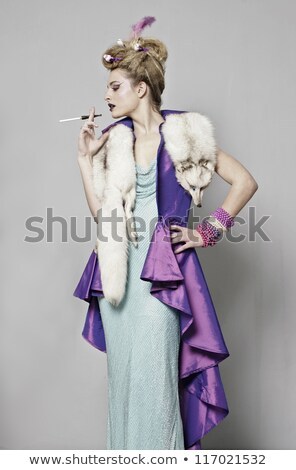 portrait of blonde lady with cigarette in hand thinking stock photo © pawelsierakowski