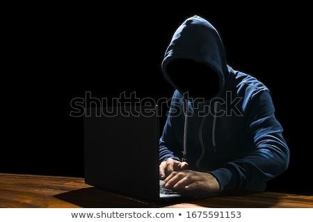Számítógép bűnöző kéz középkorú felnőtt férfi tart Stock fotó © eldadcarin