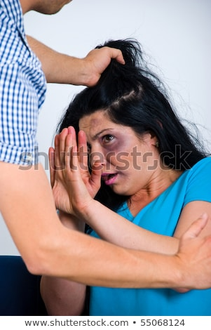 terrified abused woman trying to stop the attack and defend hers stock photo © dacasdo