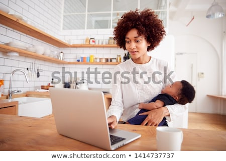 Baby on computer. Stock photo © iofoto