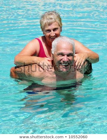 Old lady enjoying piggyride Stock photo © get4net