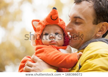 young father and his little son in fox costume stock photo © photobac