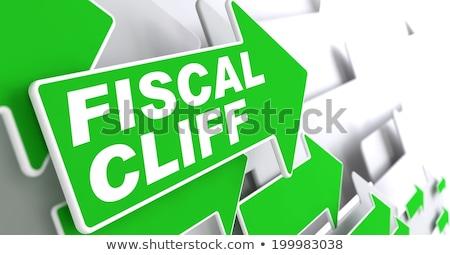 Fiscal Cliff on Green Direction Arrow Sign. Stock photo © tashatuvango