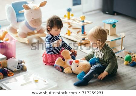 Stock fotó: Baba · játszik · játékok · lefelé · néz · színes · vízszintes