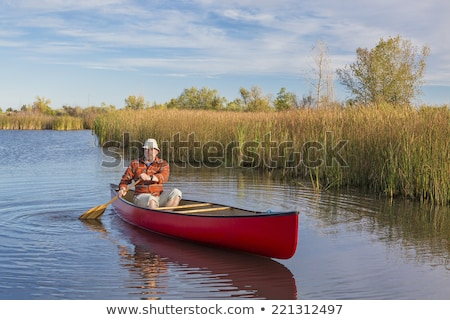 canoe and cattails Stock photo © PixelsAway