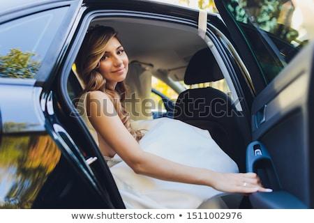 Nő pózol és körül régi autó gyönyörű nő Stock fotó © tobkatrina