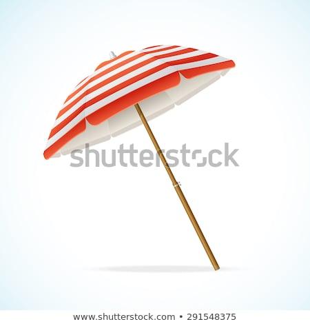 Nap esernyők leragasztott kavics tengerpart kék Stock fotó © vrvalerian