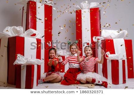 Elf Girl Leaning On Present For Christmas Stock photo © LironPeer