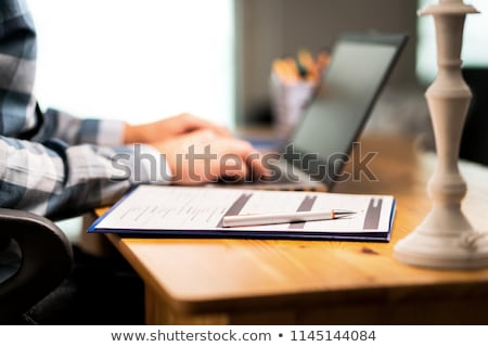 Man completing a customer survey Stock photo © hd_premium_shots