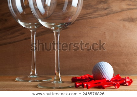 Two glasses  of wine and golf equipments Stock photo © CaptureLight