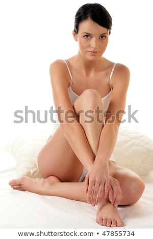 Csinos nő ül ágy lábak keresztbe szexi fiatal Stock fotó © dash