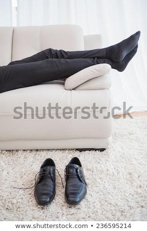 Affaires canapé jambes visible maison salon Photo stock © wavebreak_media