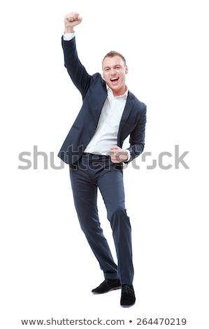 Iş adamı kazanan el yukarı yalıtılmış gülümseme Stok fotoğraf © fuzzbones0