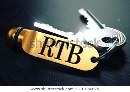 RTB - Bunch of Keys with Text on Golden Keychain. Stock photo © tashatuvango