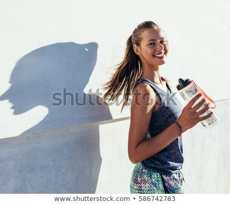 belle · femme · bouteille · eau · blanche · femme · vert - photo stock © dolgachov