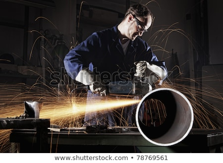 Worker grinding steel pipe with grinder Stock photo © stevanovicigor