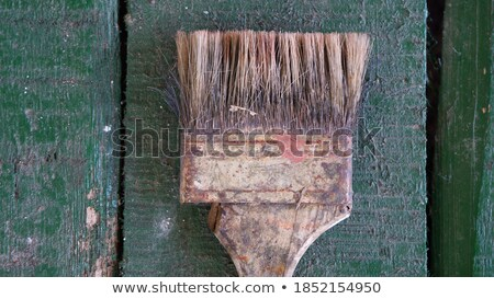 Old paintbrush and spatula on rustic wooden board Stock photo © stevanovicigor