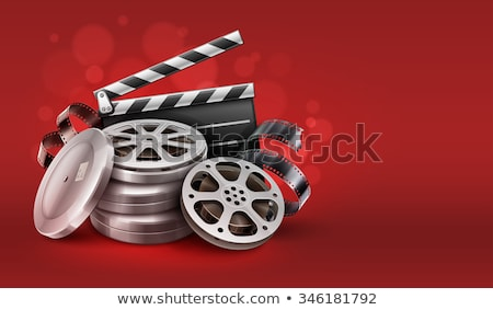 Movie film disks with directors clapper for cinematography Stock photo © LoopAll