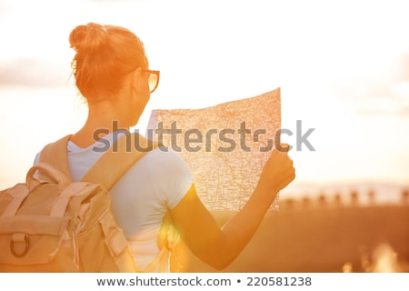 traveler girl searching right direction on map freedom and act stock photo © vlad_star