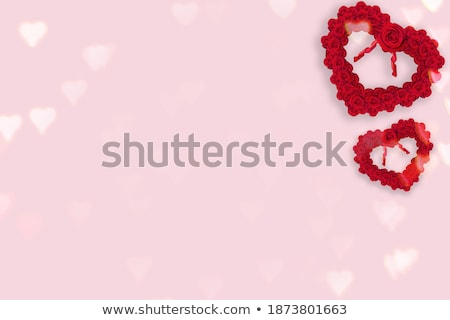 frame with a roses and bokeh shape of hearts stock photo © boroda
