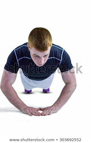 Muscular rugby jugador flexiones blanco deporte Foto stock © wavebreak_media