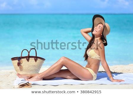 Woman on vacation wearing beach hat bathing in ocean Stock photo © Kzenon