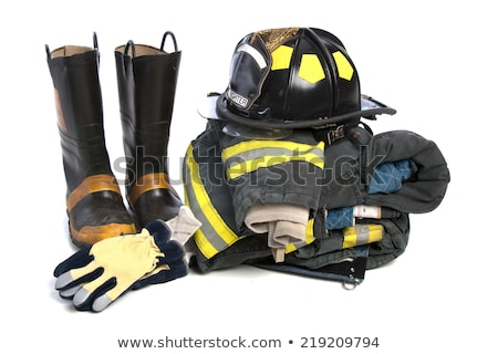 A fireman wearing a yellow uniform Stock photo © bluering