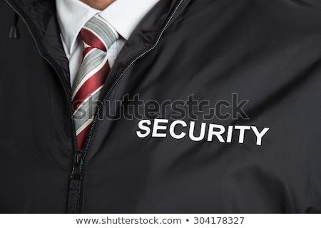 primer · plano · jóvenes · masculina · guardia · de · seguridad · los · brazos · cruzados · policía - foto stock © andreypopov