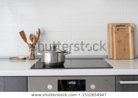 Kitchen utensils, pots and induction hobs.  Stock photo © justinb