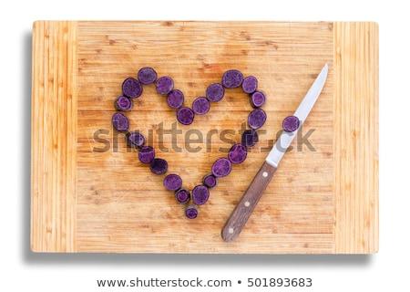 Chopped carrots arranged in heart shape Stock photo © ozgur