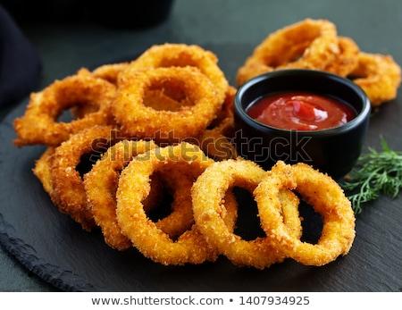 Cipolla anelli fast food tavola cena grasso Foto d'archivio © racoolstudio