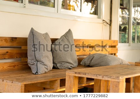 A chair furniture with a checkered pillow Stock photo © bluering