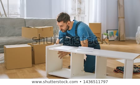 Man assembling furniture at home, hand with screwdriver Stock photo © stevanovicigor