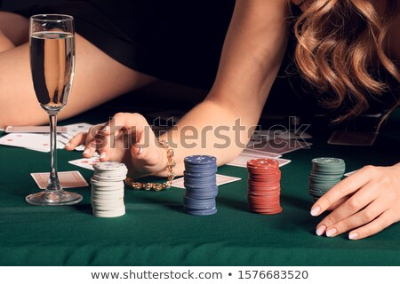 Beautiful female poker player Stock photo © artistrobd