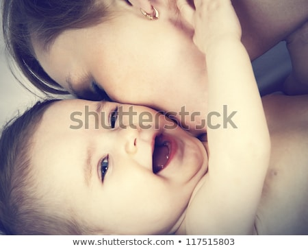 Close-up of happy Mother kissing Baby's feet her Newborn baby gi Stock photo © Victoria_Andreas