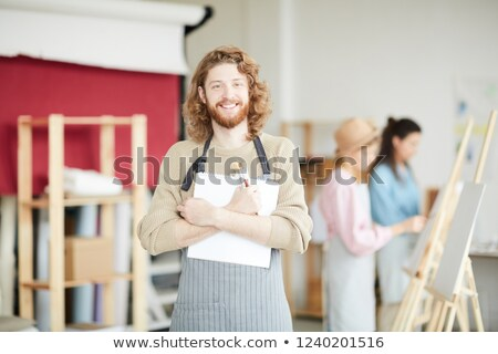 happy student holding notepad at his chest  Stock photo © feedough