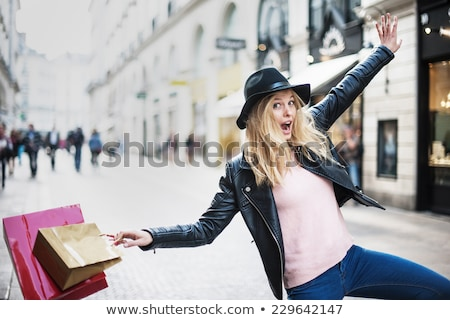 laughing young woman in leather jacket posing  Stock photo © feedough