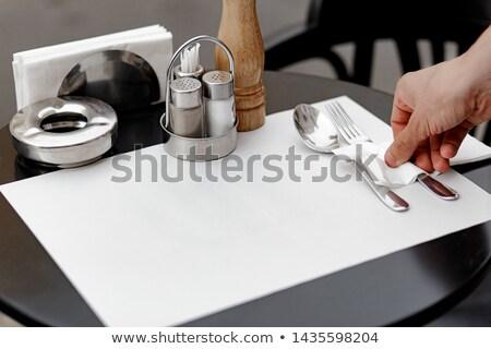 Waitress setting table in restaurant Stock photo © wavebreak_media