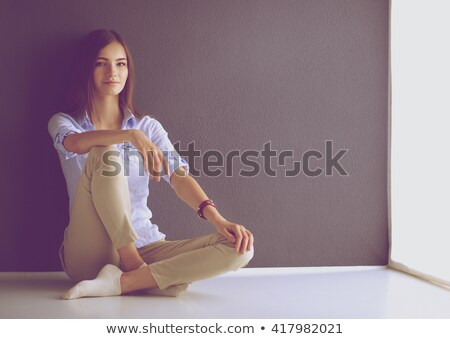 long legged model near wall Stock photo © ssuaphoto