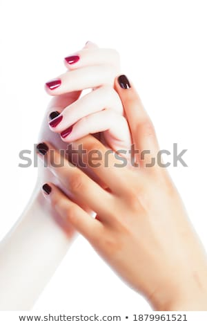 two different nathion manicured hands on white isolated Stock photo © iordani