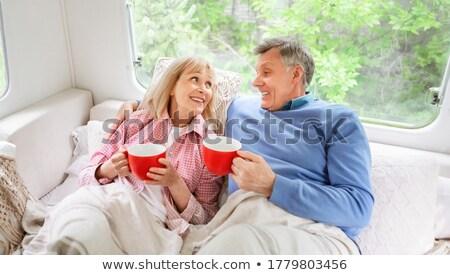 Mature couple lying in camper van Stock photo © IS2