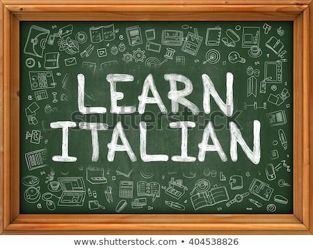 learn italian concept green chalkboard with doodle icons stock photo © tashatuvango