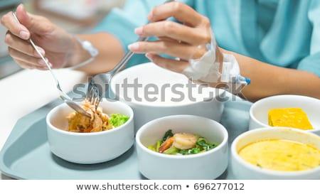 Fiatal nő eszik kórház étel nő orvosi Stock fotó © monkey_business