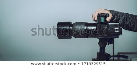 photographer holding full frame sensor dslr camera stock photo © stevanovicigor