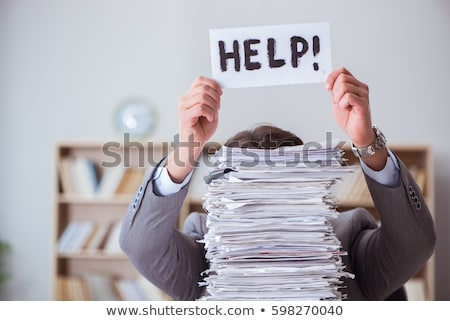 man in office with pile of paperwork stock photo © is2