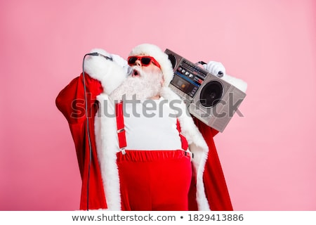 Santa claus singing a christmas songs Stock photo © wavebreak_media