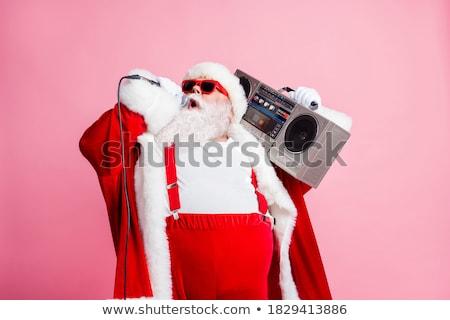 Święty mikołaj śpiewu christmas człowiek zimą zabawy Zdjęcia stock © wavebreak_media